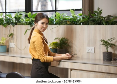 Portrait woman at counter in coworking space
