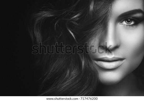 Portrait of  Woman with curly hair and beautiful make-up