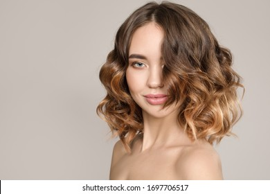 Portrait of a woman with curly hair. Short haircut. Hair care concept