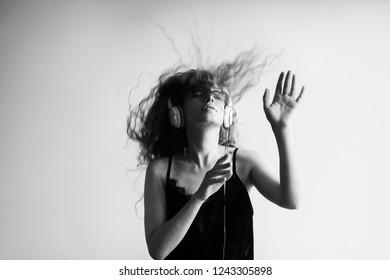 Portrait of woman dj enjoying music on headphones