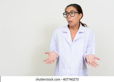 Portrait of woman doctor shrugging shoulders