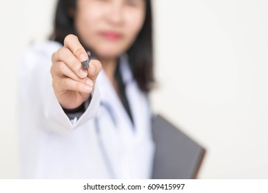 Portrait of woman doctor use pen with white background
