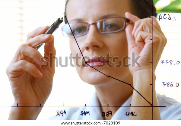 portrait of woman doing her job in office environment
