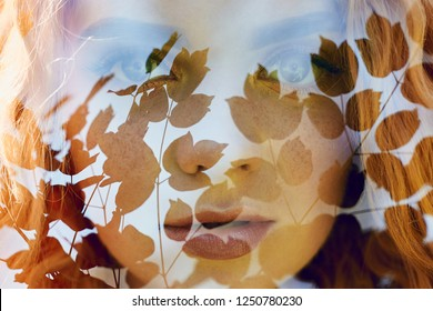 Portrait of a woman with a double exposure, the girl and the blurred nature of the photo is not in focus. The leaves on the woman's face