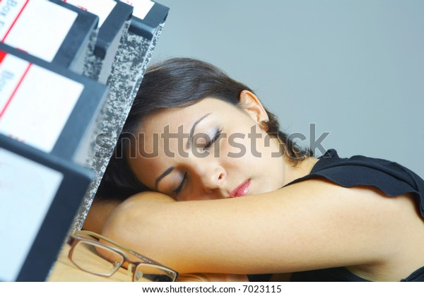 portrait of a woman dozing on her working place