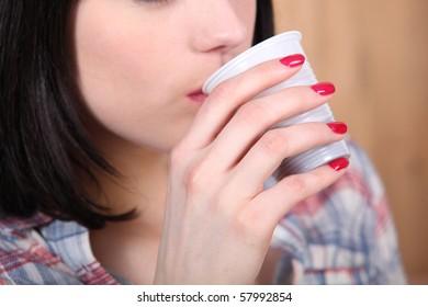 Portrait of a woman drinking