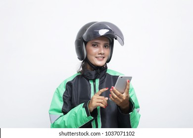 portrait woman driver transportation motorcycle gojek, grab, uber touch mobile for order taxi