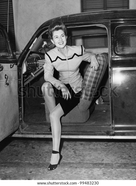 Portrait of woman in drivers seat of car