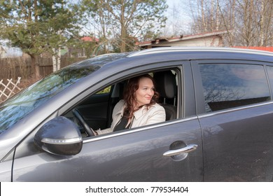 portrait of a woman driving a car
