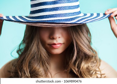 Portrait of a woman in elegant hat with a wide brim. Beauty, fashion concept. Close up