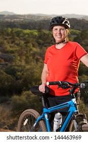 Portrait of Woman Enjoying Recreational Mountain Biking