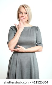 Portrait  woman with finger on lips, or secret gesture hand sign  isolated on white background