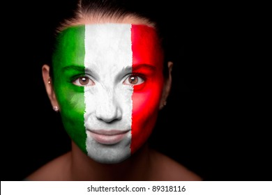 Portrait of a woman with the flag of the Italy painted on her face.