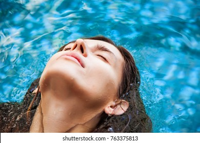 portrait of a woman floating in the pool