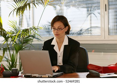 portrait of a woman in front of a laptop computer