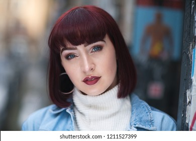 Portrait of woman with ginger hair white turtle neck, denim shir