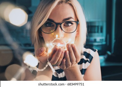 Portrait of woman in glasses with led fibre