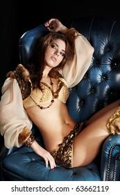 Portrait of woman in gold dress