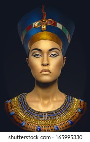 Portrait of woman with golden skin in Egyptian style