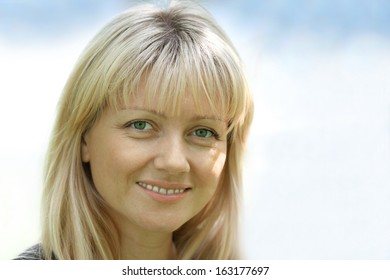Portrait of the woman with green eyes of 38 years at a sunlight