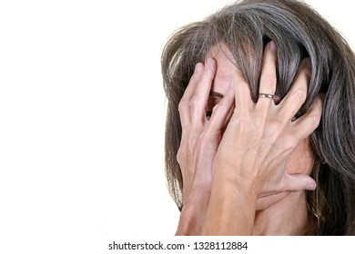 Portrait of a Woman with HAnds Covering Face Depicting Emotional Moment