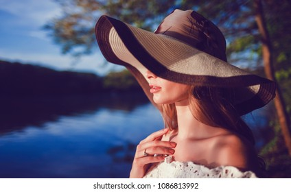 portrait woman in hat on nature
