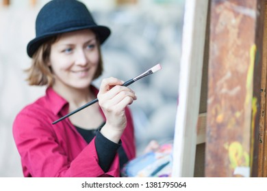 portrait of a woman with hat painting