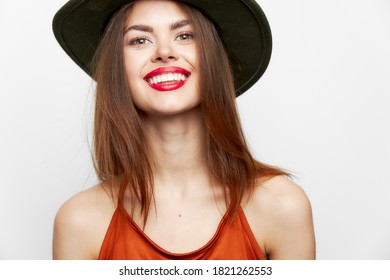 Portrait of a woman in a hat Wide smile charm bare shoulders evening makeup