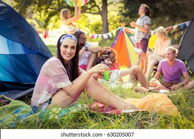 Portrait of woman having fun at campsite on a sunny day