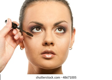 portrait of woman having on the person a make-up, is isolated on  white
