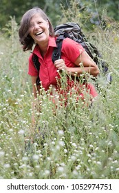 portrait of woman in her 50s hiking in nature