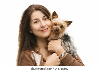 Portrait of a woman holding a cute yorkshire terrier isolated over white.