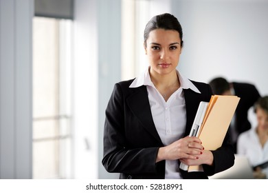 Portrait of a woman holding documents