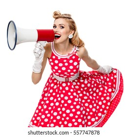Portrait of woman holding megaphone, in pin-up style red dress in polka dot and gloves, isolated on white background. Caucasian blond model posing in retro fashion vintage shoot. Square composition.