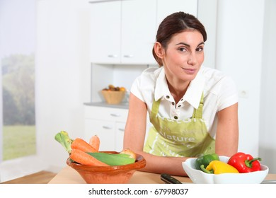 Portrait of woman in home kitchen