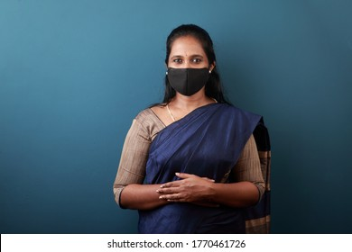 Portrait of a  woman of Indian origin wearing face mask to protect against viral pandemic