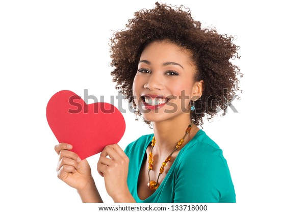Portrait Of Woman Isolated Holding Heart Shape Over White Background