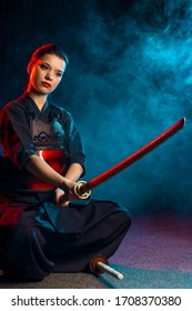 portrait of woman kendo fighter isolated. japanese martial art of sword fighting. female ready to fight. strong combat fight