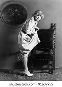 Portrait of woman lifting dress