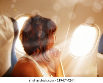 Portrait of a woman looking from airplane window
