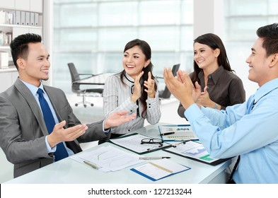 Portrait of a woman and man office workers  clapping salute their team