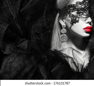 portrait of a woman in mask black and white
