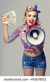 Portrait of woman with money and megaphone, dressed in pin-up style. Caucasian blond model posing in retro fashion and vintage studio shoot - banking, finance, credit, sales and proposition concept.