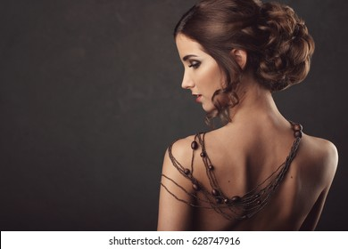 portrait of woman with naked back with necklace
