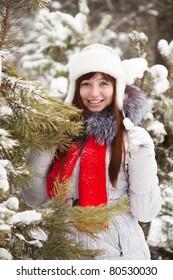 Portrait of  woman near pine tree in winter