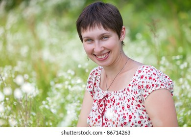 Portrait of a woman on chamomile background
