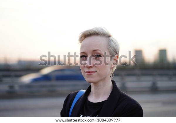 portrait of woman on city background
