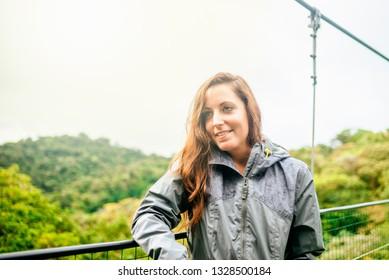 Portrait of woman on suspension bridge in Monteverde, Costa RIca.