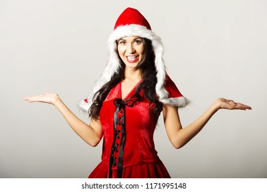 Portrait of woman with open hands gesture wearing santa clothes.