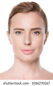 Portrait of woman with painted lines on face for plastic surgery isolateed on white